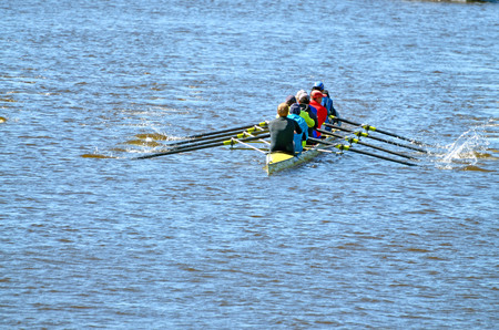 A team of rowers in a sports boat.The training takes place on the river.