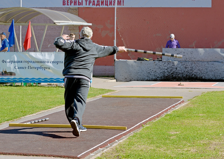 Saint-Petersburg.Russia.may.06.2017.Gorodki - a Russian folk sports game. In this game you need specific distances to smash figures made in different ways from five wooden cylinders.