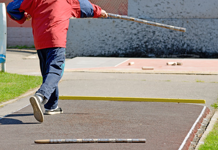 Russian folk sports game, specific distances to smash figures made in different ways from five wooden cylinders.