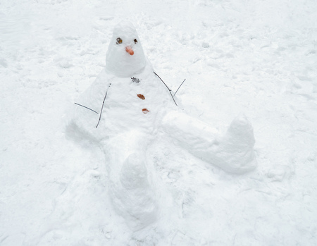 Snowman cobbled together by children.This traditional winter pastime. Stock Photo