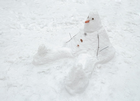 Snowman cobbled together by children.This traditional winter pastime. Stock fotó