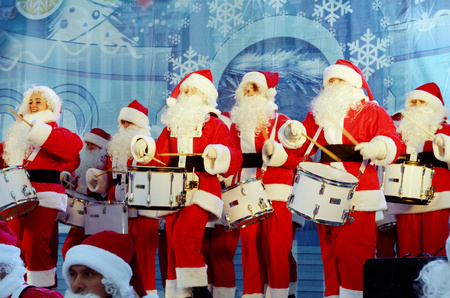 Saint-Petersburg.Russia.December.22.2018.Musicians in the form of Santa Claus.On Christmas eve give a concert in front of the audience.They play drums.Perform at the Palace square.