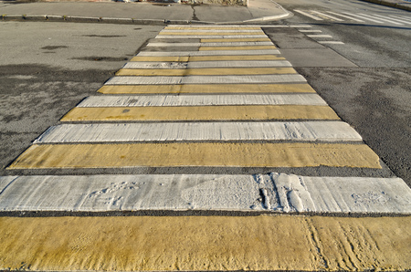 Marking pedestrian crossing.In the form of parallel white stripe .