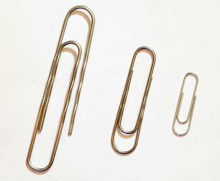 The paper clip is used to fasten paper sheets.Its a stationery tool. Stock Photo