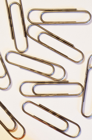 The paper clip is used to fasten paper sheets.It's a stationery tool. Stock Photo - 115157142