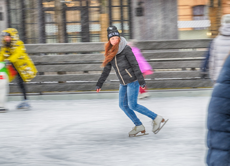 Saint-Petersburg.Russia.December.2.2018.Skating on the ice rink.Its good for your health.An active lifestyle brings a lot of joy.