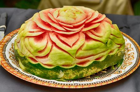 carving sculptures from watermelons.Artists create works of art.This art was born in Thailand.