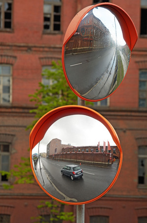 A spherical security mirror.This is a useful tool.It helps to maneuver on difficult sections of the road. Reklamní fotografie