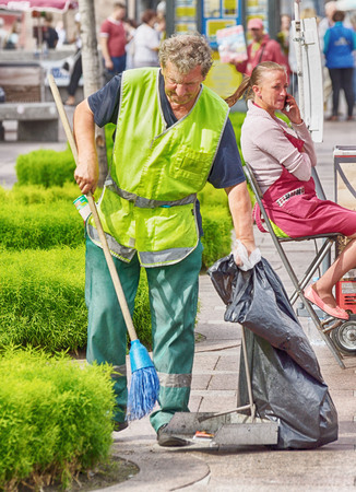 Saint-Petersburg.Russia.August.19.2018.On the streets of the city are janitors.They clean the streets and keep them clean.