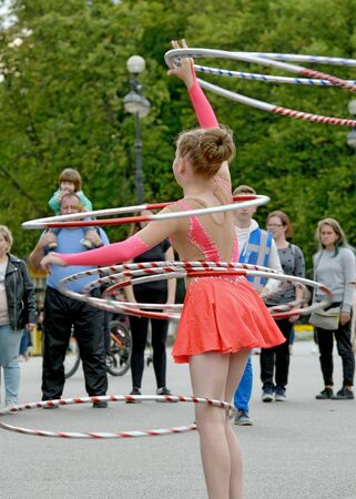 Saint-Petersburg.Russia.August 23.2019.The girl twists the hoop with her body.She has a flexible and hardy body.
