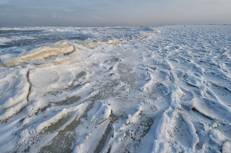 The Bay is covered with ice.Frost had formed from the snow a beautiful texture.