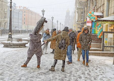 Saint-Petersburg.Russia.December 01.2019.The work of advertising agents.In costumes of animated characters.They offer to take a picture for memory. Reklamní fotografie - 135439525