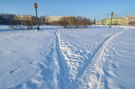 A path in the snow trodden by people.It is cold and snowy in winter.