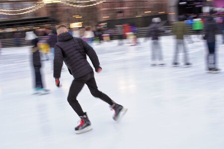 Skating on the ice rink.Its good for your health.
