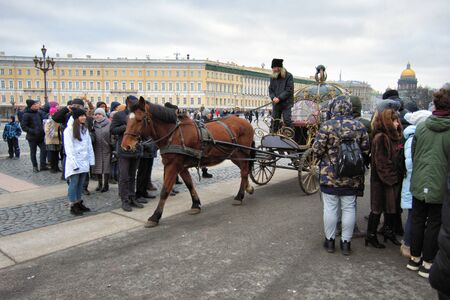 St. Petersburg. Russia. January 02.2020.Palace Square.Horse carriage tour in the city center.Guests of the city can ride in the horse-drawn carriage with the whole family through the streets.
