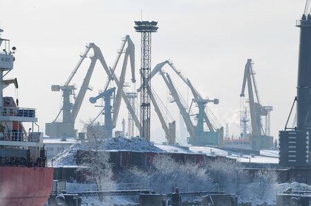 Seaport in the winter.Here, loading and unloading of ships is carried out. Imagens