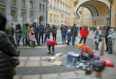 Saint-Petersburg.Russia.February 01.2020.Street artists painting their paintings with spray cans.Artists paint with aerosol paints.Do it quickly and beautifully.