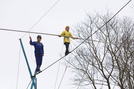 Saint - Petersburg.Russia.March 1.2020.Uzbek tightrope walkers perform at the festival of farewell to winter.This is a spectacular and dangerous attraction.