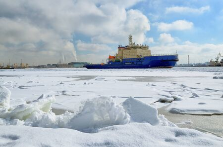 The water area of the port in winter.The water in the bay is covered with ice.