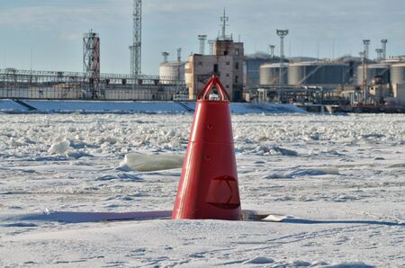 Red buoy on the river.This ensures the safety of the movement of ships.