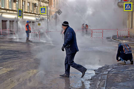Saint-Petersburg.Russia.March.28.2018.There was a breakthrough of a heating main with hot water.The incident occurred on Stolyarnyy pereulok near Sennaya square.Rescuers arrived. Editorial