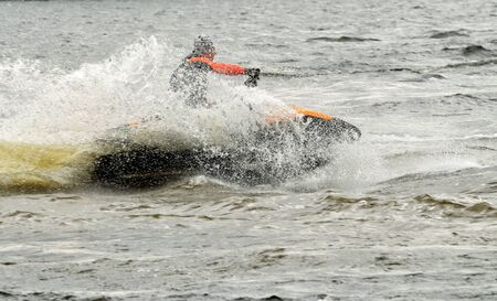 Fast scooter ride on the sea.When you turn the boat flying spray of water.