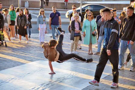 St. Petersburg. Russia. June 20.2020.The guys are dancing break dance on the street.They gather around them spectators.And demonstrate their skills in dance.