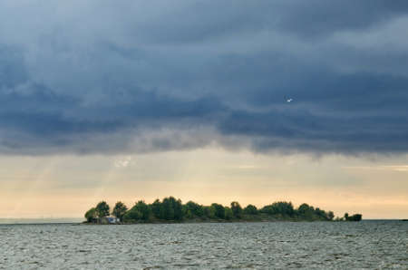 Thunderclouds in the sky over the sea.It is raining heavily. Foto de archivo
