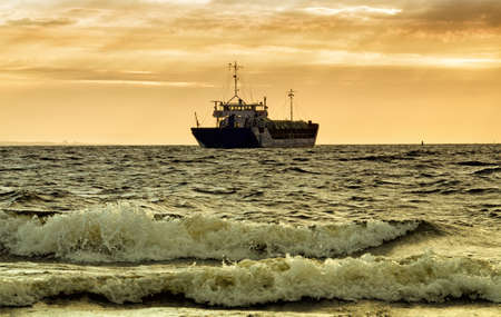 The ship is sailing on the sea.Beautiful landscape with sea waves.