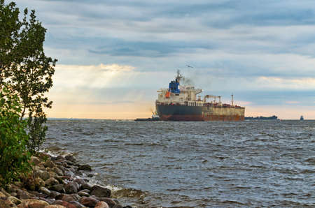The big ship goes to sea.This is a commercial cargo ship.