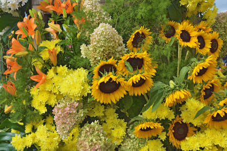 Bright flower arrangement.There are beautiful sunflowers in the center of the bouquet.