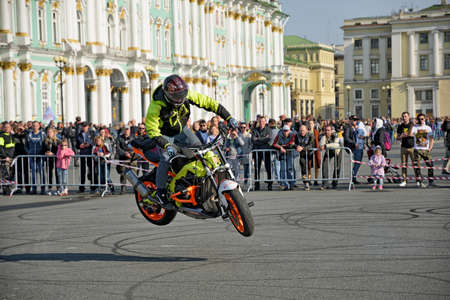 Saint Petersburg, Russia. September 26.2020.A biker festival is taking place. a biker demonstrates difficult and dangerous stunts on his motorcycle.This underlines his mastery of technique.