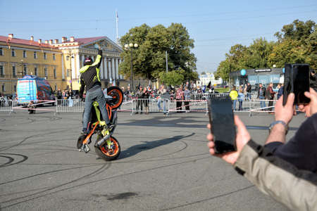 Saint Petersburg. Russia. September 26.2020.A biker festival is taking place. a biker demonstrates difficult and dangerous stunts on his motorcycle.This underlines his mastery of technique.