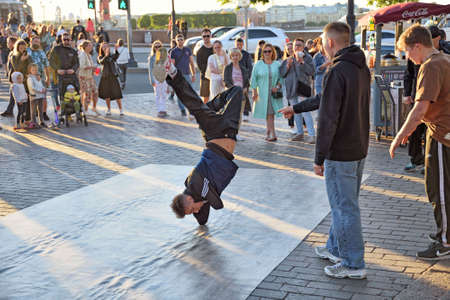 St. Petersburg. Russia. June 20.2020 The guys are dancing break dance on the street.They gather around them spectators.And demonstrate their skills in dance.