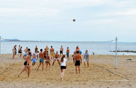 Saint Petersburg. Russia. August 9.2014. Young people play volleyball on the beach.It's a nice outdoor activity during the weekend.