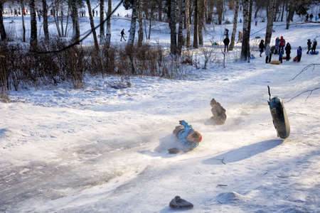 Russia. St. Petersburg. January 09.2021. Shuvalov park Sledding from a high mountain, Both adults and children love to sled fast. People love extreme descent.