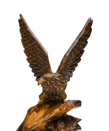 wooden figure: Cut wooden figure of an eagle on a white background