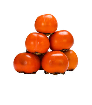 effloresce: mature persimmon pyramid isolated on white background. Stock Photo