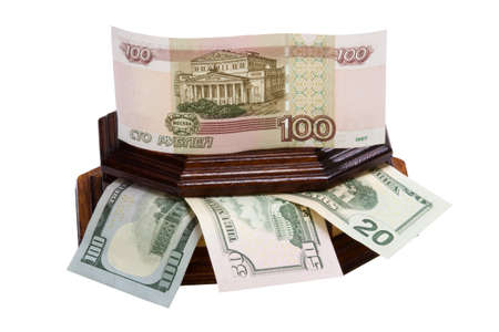 Money in a box rubles and dollars are isolated on a white background.