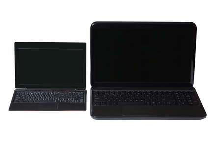 netbook: Netbook and notebook on a white background with black screen and keyboard.
