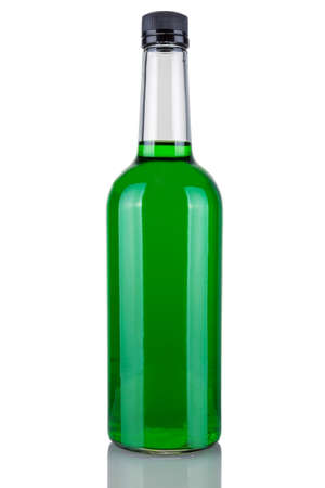 Bottle alcohol absinthe, green liquid in a bottle isolated on a white background.