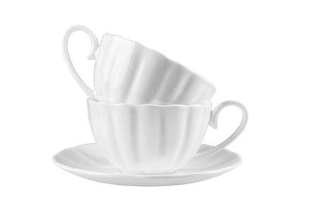 Two ceramic cups on a saucer, it is isolated on a white background.