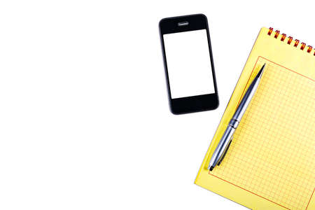 Notepad with pen, isolated on a white background with a phone. 版權商用圖片
