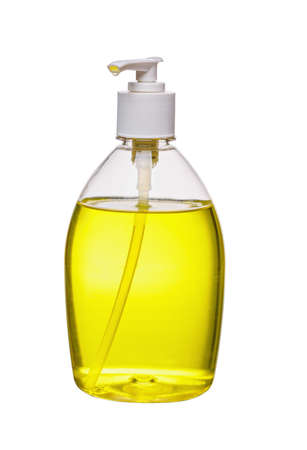 Liquid soap bottle, yellow fluid in a bottle, isolated on a white background. 版權商用圖片