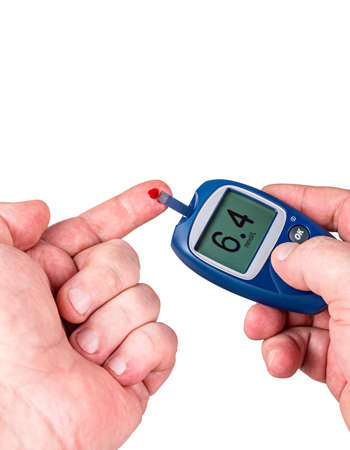 Drop of blood glucose, with monitor isolated on white background.