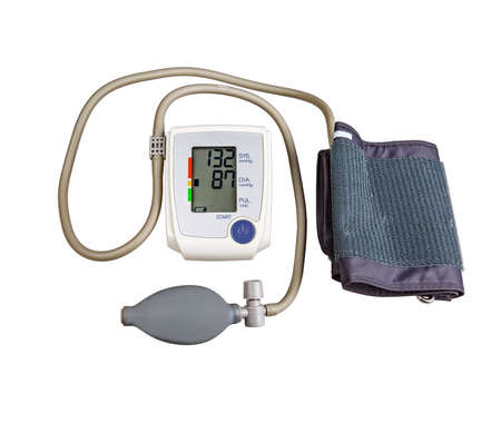 Blood pressure monitor, with pear and cuff isolated on white background. Stock Photo
