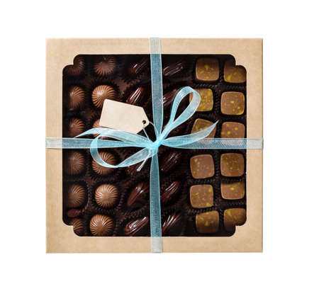 Chocolate candy in a gift box, isolated on white background.