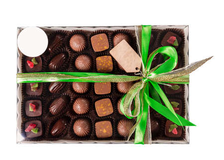 Box of chocolates with ribbon, isolated on white background.