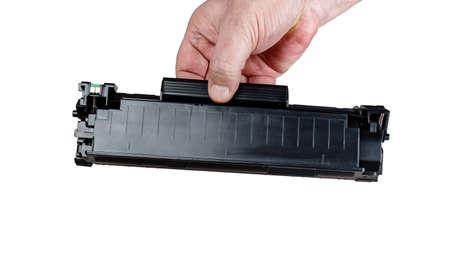 Cartridge for printer in hand, isolated on white background