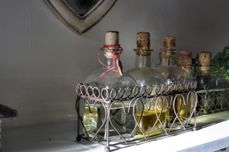 spices in bottles with cork - oil, vinegar, wine photo